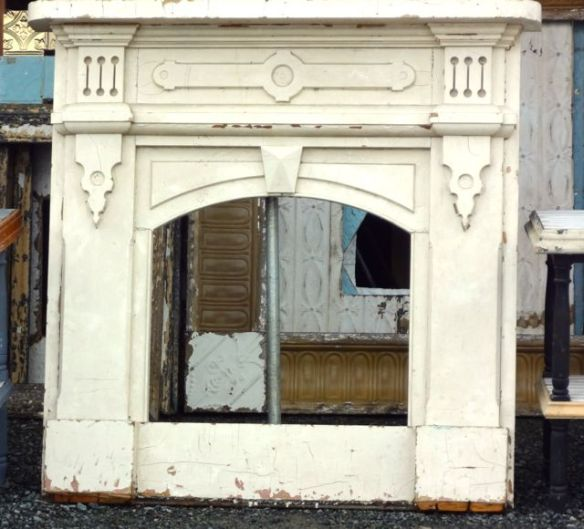What a gorgeous faux mantle!  If we didn't have a fireplace, then I would have scooped this up.